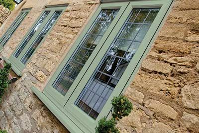 Green coloured wood effect uPVC windows